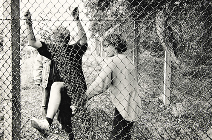 web_slide_lyn_barlow_and_two_other_women_breaking_through_the_fence_at_greenham_common_1980s